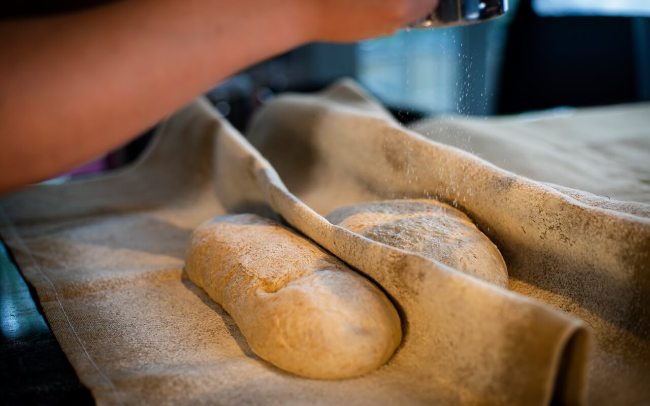French Country Bread Proofing In Bakers Couche