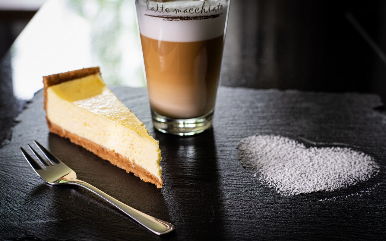 The Perfect New York Cheesecake Piece With Latte Macchiato