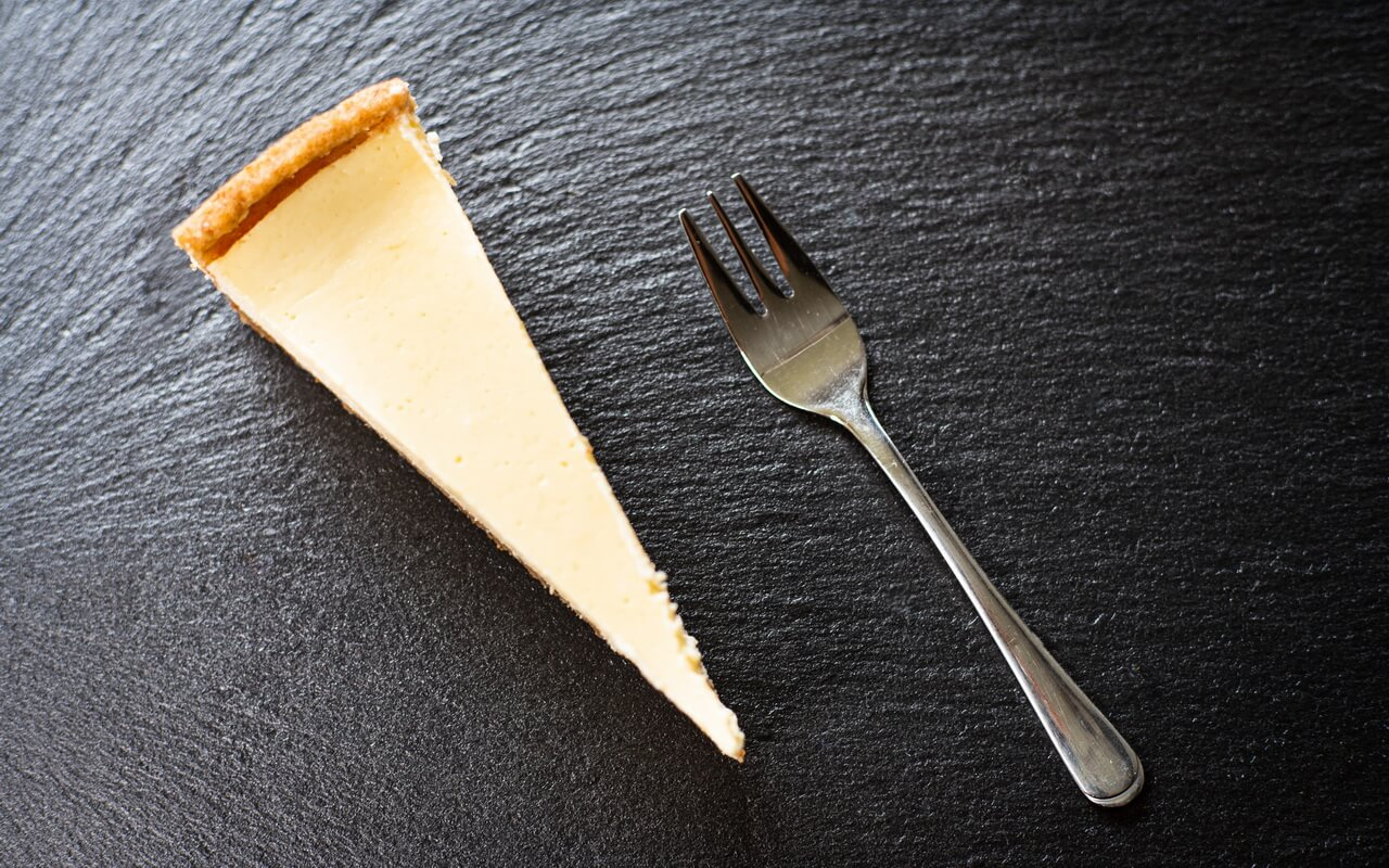 The Perfect New York Cheesecake Top View From Piece