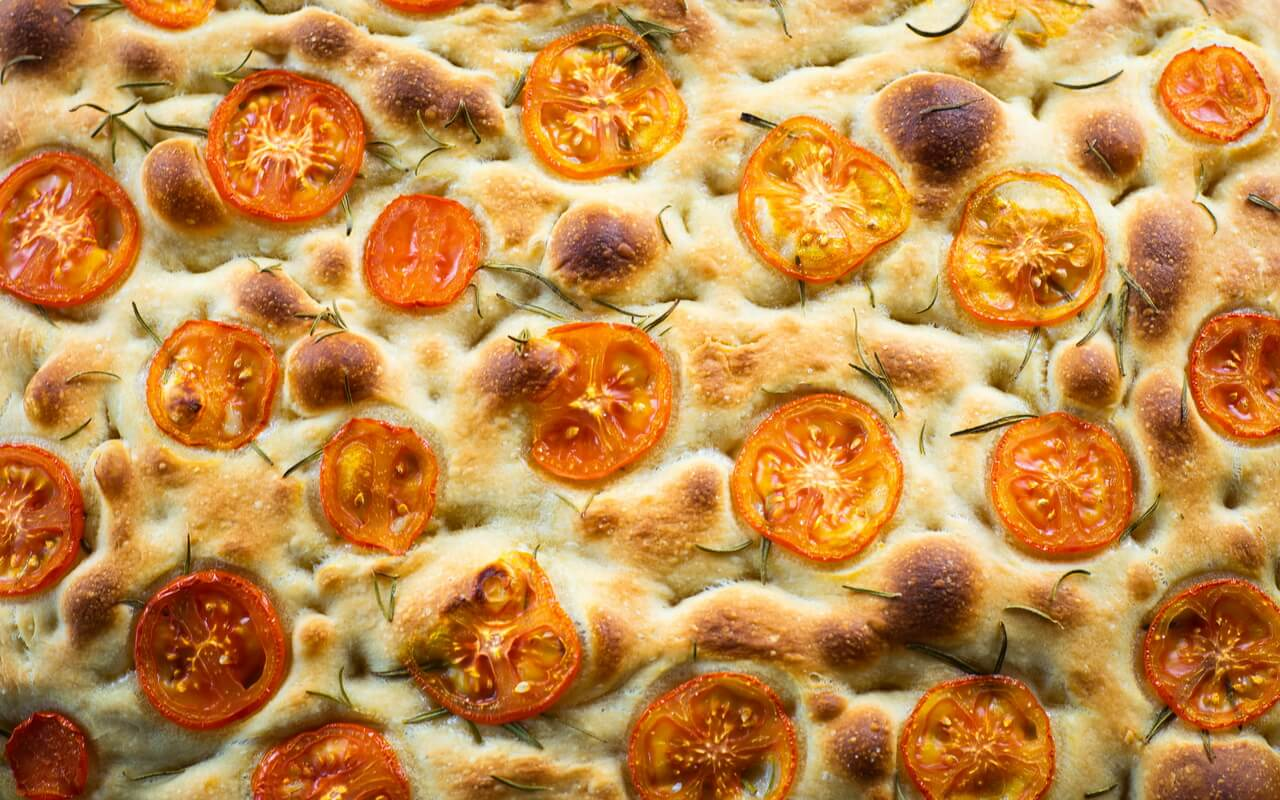 Sourdough Focaccia With Rosemary And Tomatoes Close up