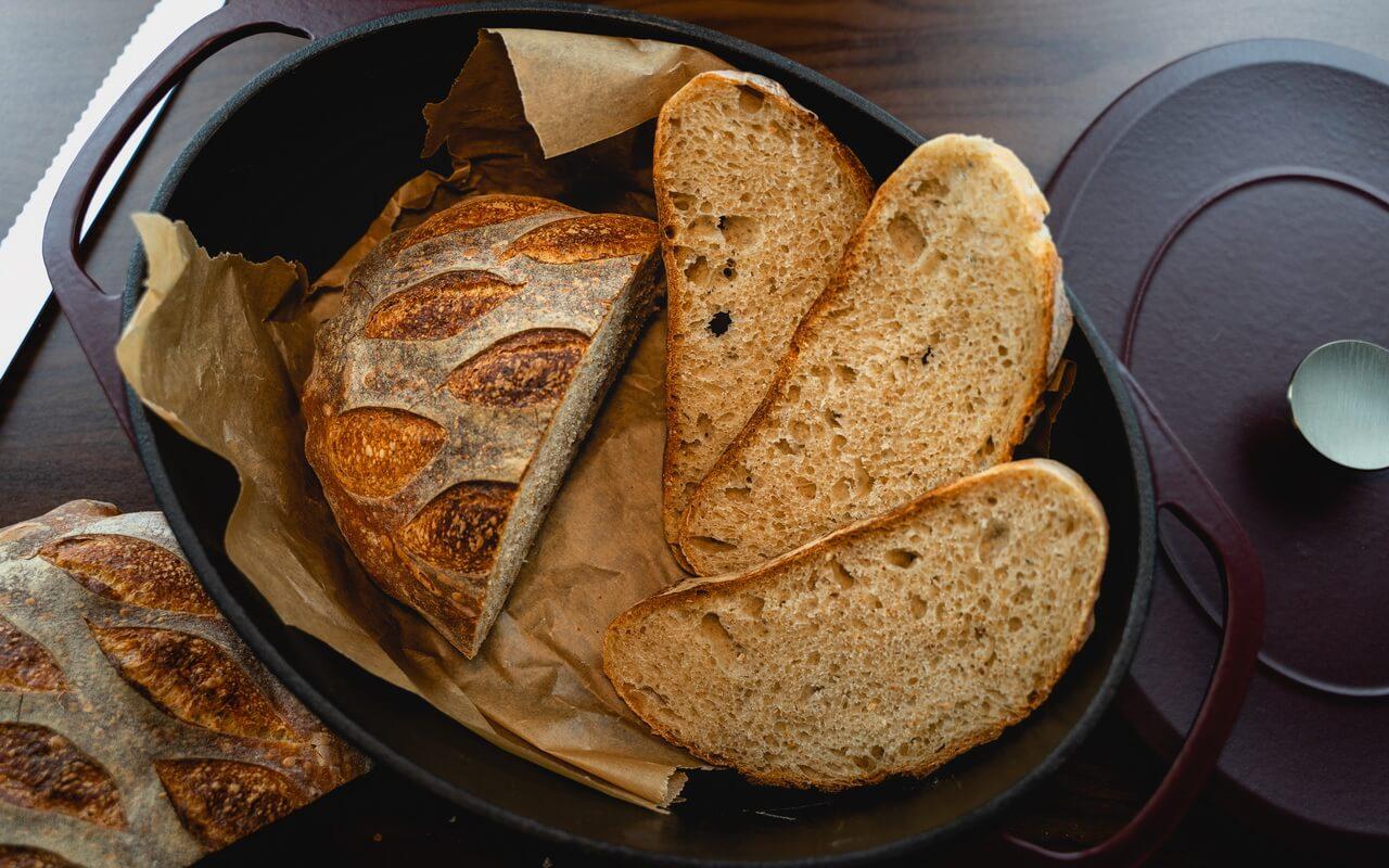 White Spelt Flour Sourdough Bread Slices In Dutch Oven