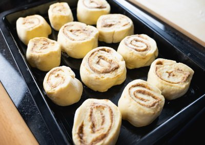 Homemade Cinnamon Rolls Shaped Pieces On Baking Plate