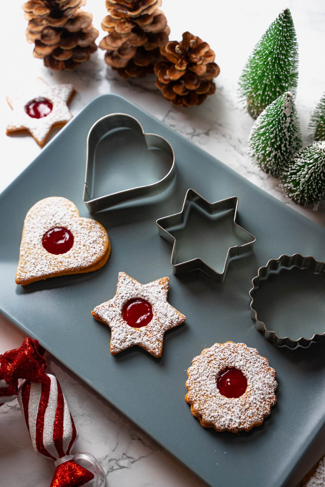 Traditional Linzer Cookies Next To Cookie Cutter Vertical