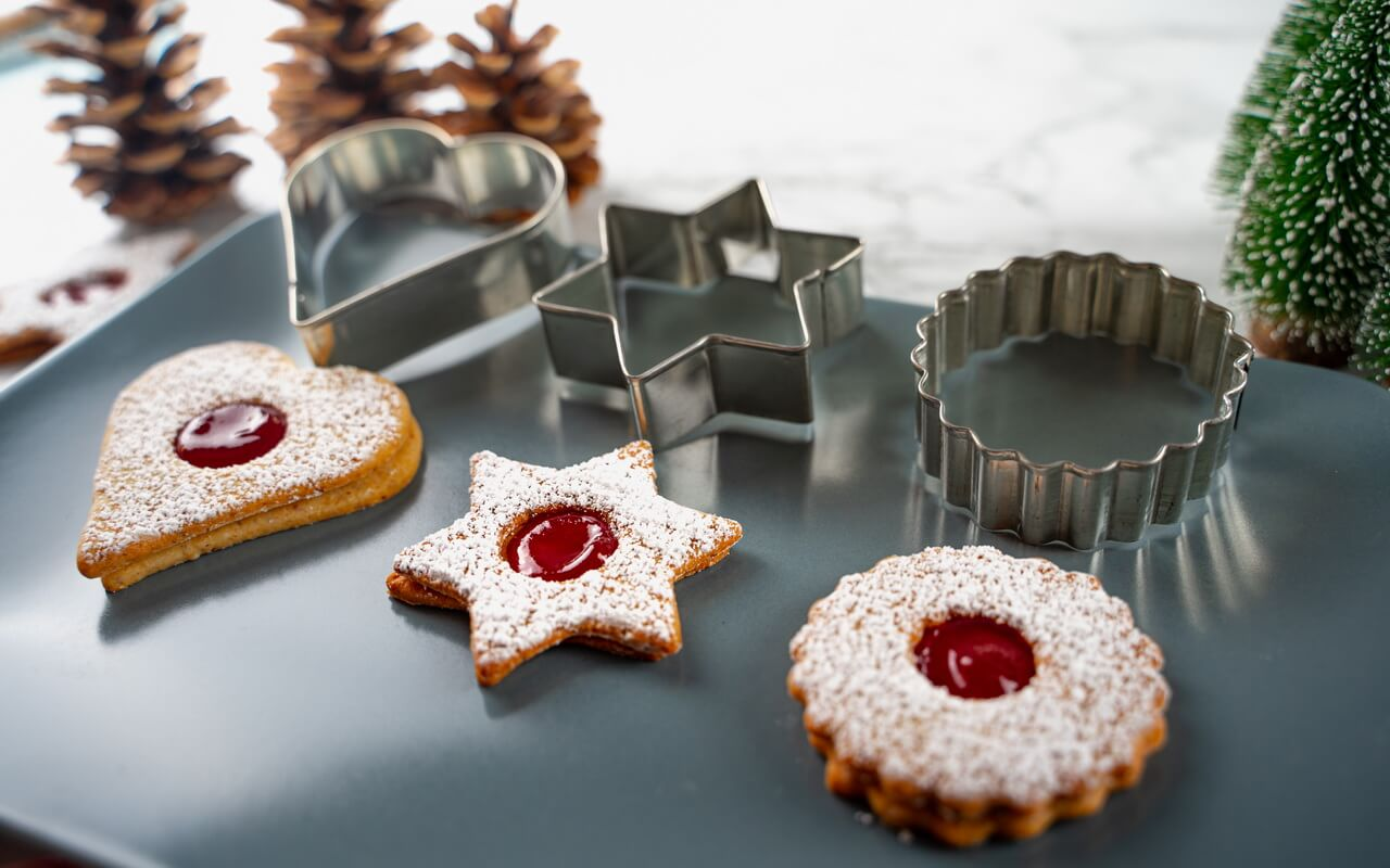 Traditional Linzer Cookies Next To Cookie Cutters