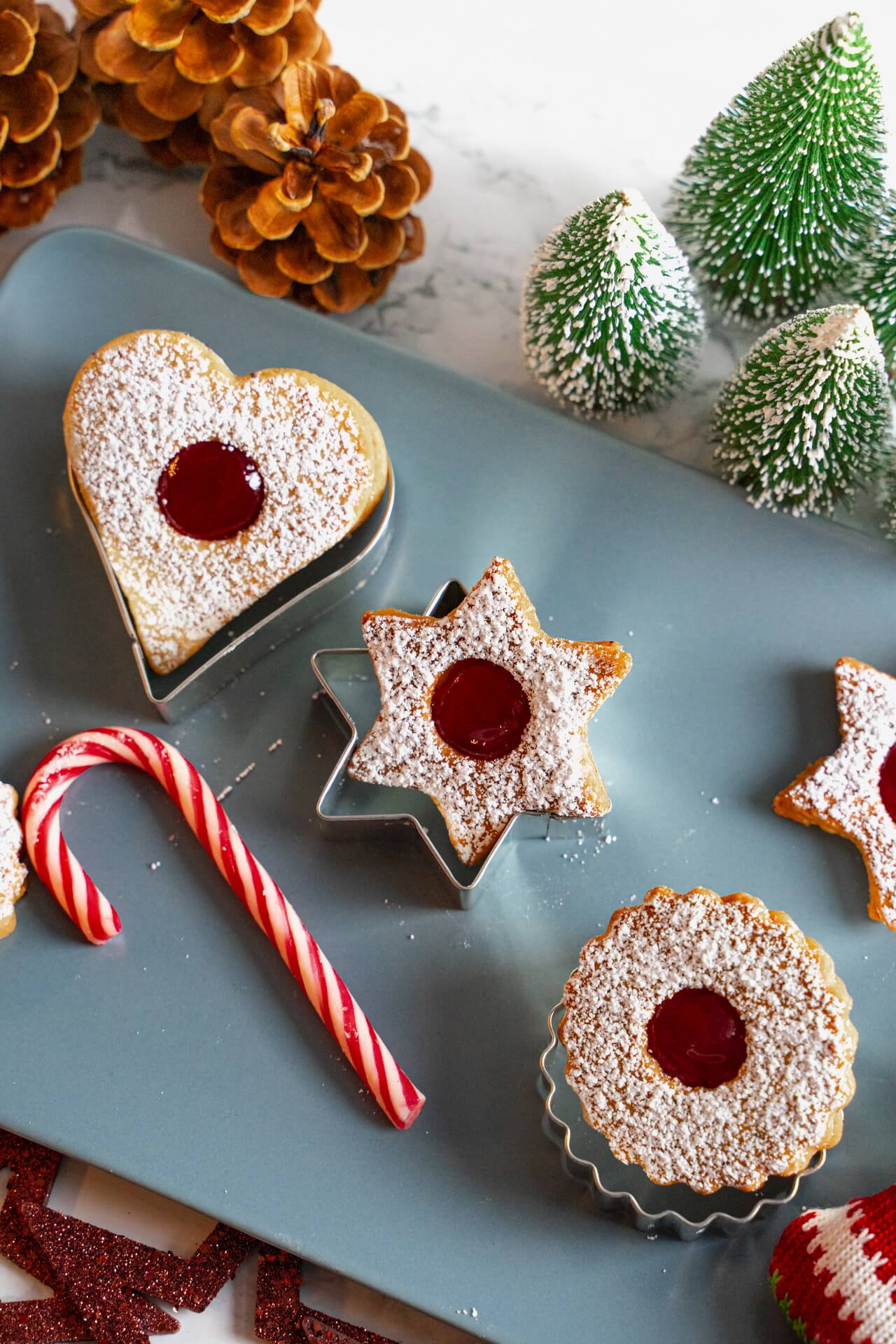 Traditional Linzer Cookies On Top Of Cookie Cutters Vertical
