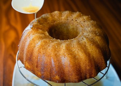 Moist Cinnamon Bundt Cake Puring Cinnamon Syrup Glaze Over Cake